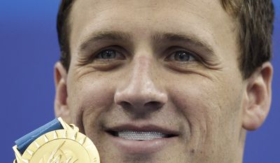 U.S. Ryan Lochte shows the gold medal he won in the men's 200m backstroke final at the FINA Swimming World Championships in Shanghai, China on Friday. (AP Photo/Michael Sohn)