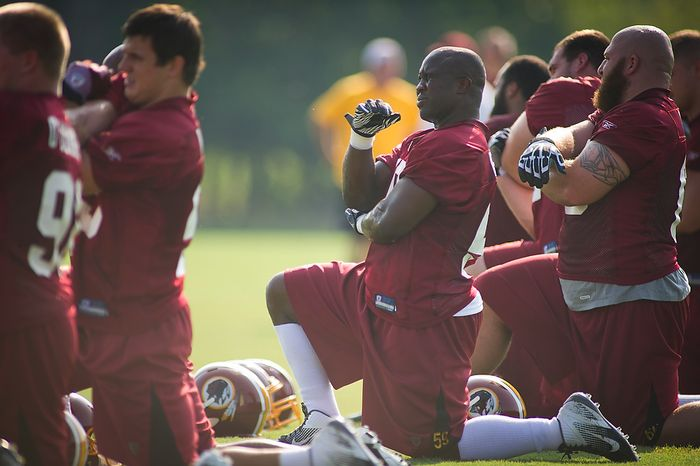 Washington Redskins linebacker London Fletcher (59) winces as he stretches during the first day of training camp at Redskins Park in Ashburn, Va., Friday, July 29, 2011. (Rod Lamkey Jr./The Washington Times)