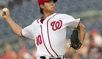 Washington Nationals starting pitcher Chien-Ming Wang made his first start in more than two years, after undergoing surgery on his shoulder to repair a torn capsule, against the New York Mets on July 29, 2011. The Nats and Wang agreed to a new one-year contract Thursday, Nov. 3, 2011. (AP Photo/Evan Vucci)