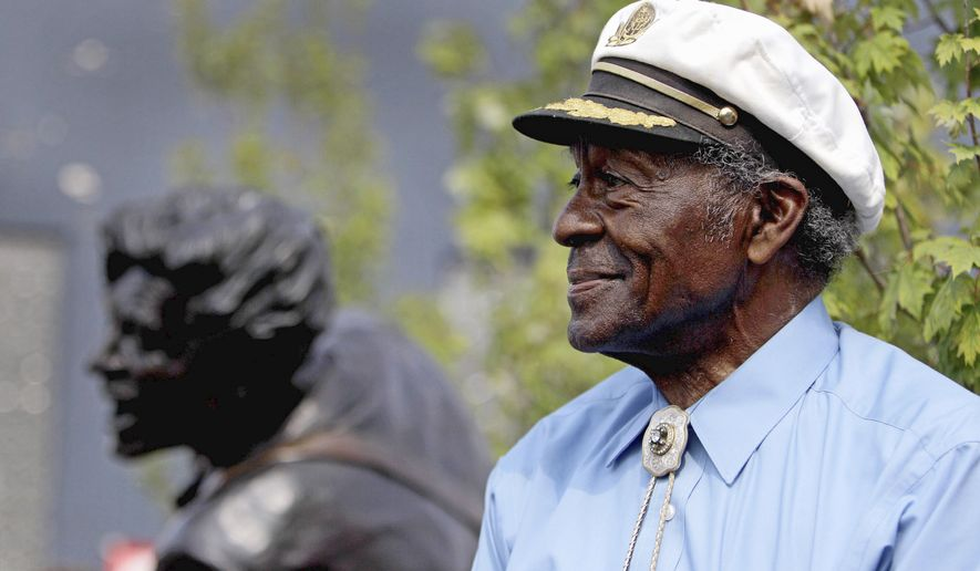 """ASSOCIATED PRESS PHOTOGRAPHS """"I don't know how to speak - I can sing a little bit,"""" said Chuck Berry in remarks to a crowd gathered for the unveiling of a statue of himself at its dedication last Friday in University City, Mo., outside St. Louis."""