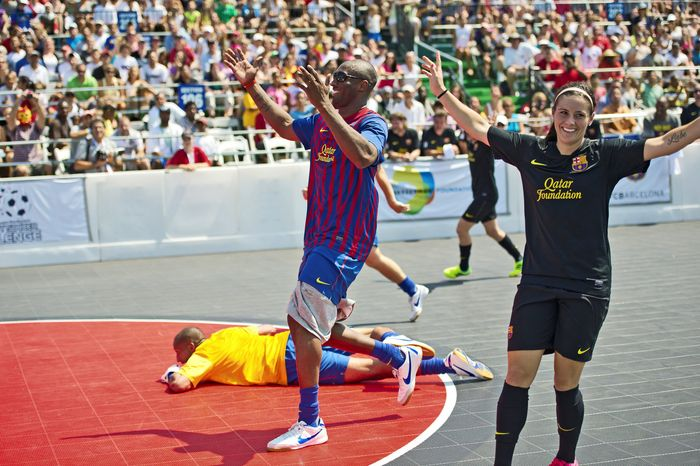 Los Angeles Lakers star Kobe Bryant and U.S. Soccer player Ali Krieger react to a near-miss Sunday during a charity soccer match played at Kastles Stadium in the District. Hosted by U.S. Soccer legend Mia Hamm, the event was held to raise awareness for bone-marrow donations.   PHOTOGRAPHS BY DREW ANGERER/THE WASHINGTON TIMES