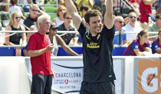 PHOTOGRAPHS BY DREW ANGERER/THE WASHINGTON TIMES Retired baseball player Nomar Garciaparra celebrates a goal during a charity soccer match Sunday at Kastles Stadium in the District. The event was hosted by Mr. Garciaparra's wife, U.S. Soccer legend Mia Hamm.