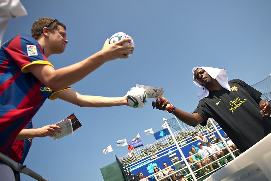 At right, Boston Celtics player Jeff Green signs autographs for GW student Josh Kramer, during the Mia Hamm and Nomar Garciaparra Celebrity Soccer Challenge, at Washington Kastles Stadium, in Washington, D.C., Sunday, July 31, 2011. (Drew Angerer/The Washington Times)