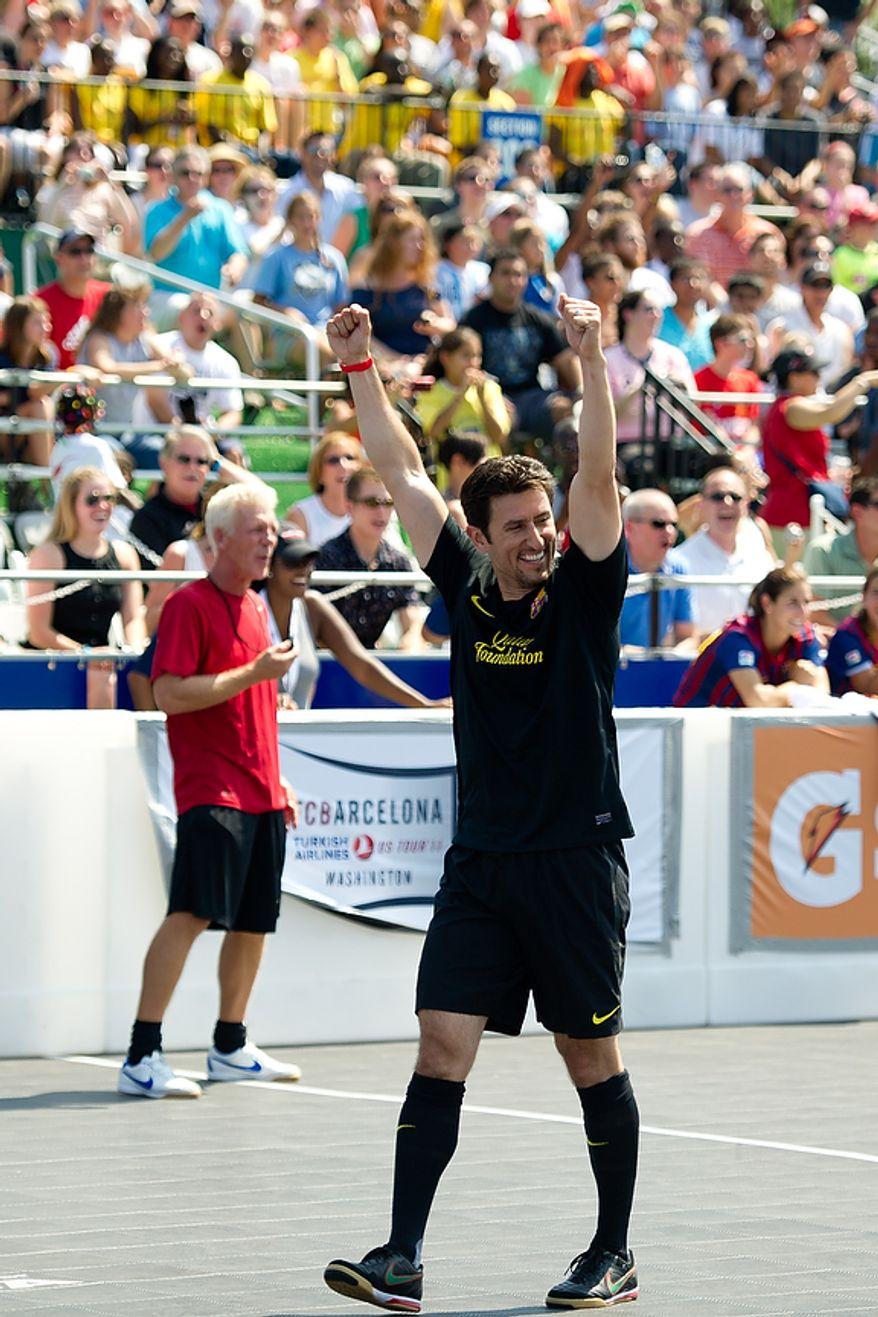 Nomar Garciaparra celebrates a goal for his team during the Mia Hamm and Nomar Garciaparra Celebrity Soccer Challenge, at Washington Kastles Stadium, in Washington, D.C., Sunday, July 31, 2011. (Drew Angerer/The Washington Times)