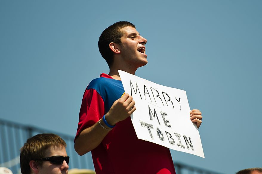 Connor Alexander, from Fairfax, Va., holds up a sign, hoping Tobin Heath, member of the U.S. Women's National Team, will marry him, during the Mia Hamm and Nomar Garciaparra Celebrity Soccer Challenge, at Washington Kastles Stadium, in Washington, D.C., Sunday, July 31, 2011. (Drew Angerer/The Washington Times)