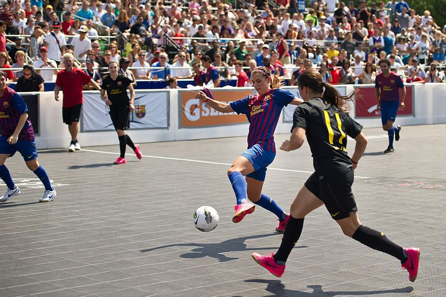 Alex Morgan, member of the U.S. Women's National Team, moves the ball downfield during the Mia Hamm and Nomar Garciaparra Celebrity Soccer Challenge, at Washington Kastles Stadium, in Washington, D.C., Sunday, July 31, 2011. (Drew Angerer/The Washington Times)