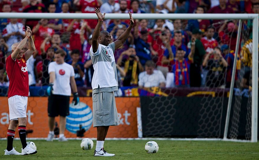 Los Angeles Lakers superstar Kobe Bryant takes the field during halftime of the 2011 Herbalife World Football Challenge match between Manchester United and FC Barcelona at FedEx Field in Landover, Md. on Saturday, July 30, 2011. (Pratik Shah/The Washington Times)