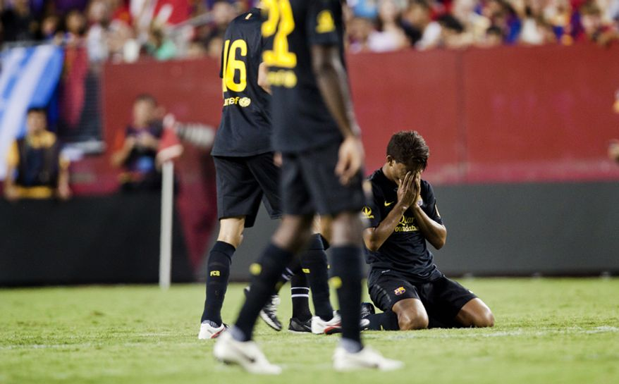 FC Barcelona midfielder Jonathan dos Santos reacts after committing a hard foul during the 2011 Herbalife World Football Challenge match between Manchester United and FC Barcelona at FedEx Field in Landover, Md. on Saturday, July 30, 2011. (Pratik Shah/The Washington Times)