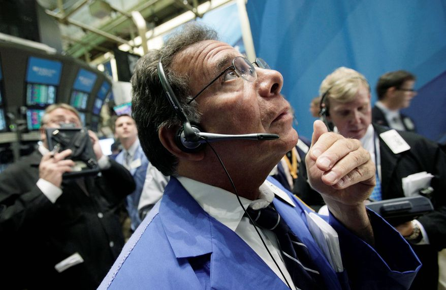 Trader Sal Saurino works on the floor of the New York Stock Exchange on Monday. There had been hope for a rally based on news of a debt-ceiling agreement on Capitol Hill. (Associated Press)