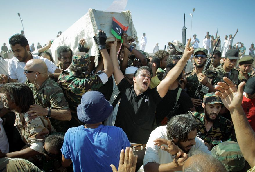 Thousands of mourners in Benghazi, Libya, marched in the funeral procession Friday for the Libyan rebels' slain military chief, Abdel-Fattah Younis, a day after he was gunned down under still mysterious circumstances. An investigation has begun. (Associated Press)