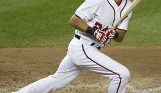 Washington Nationals' Rick Ankiel follows through on a solo home run against Atlanta Braves pitcher Jair Jurrjens during the fifth inning of a baseball game Monday, Aug. 1, 2011, in Washington. (AP Photo/Luis M. Alvarez)