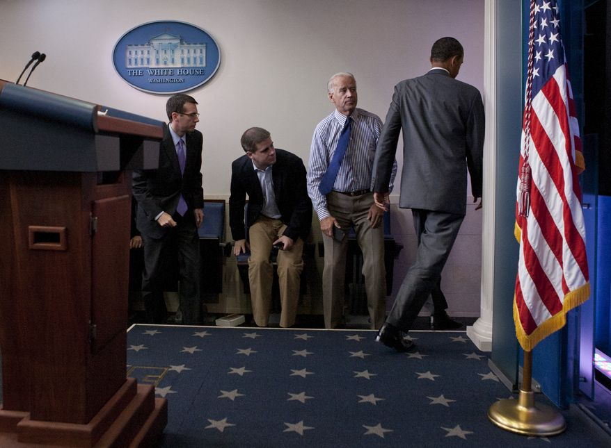 President Obama (right) turns to leave after speaking July 31, 2011, at the White House about a deal being reached to raise the debt limit with Vice President Joseph R. Biden Jr. (second from right), and White House communications director Dan Pfeiffer (third from right). (Associated Press)