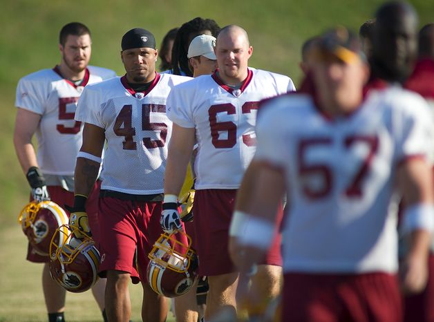 Washington Redskins full back Mike Sellers (45) arrives on the field for another day of training camp at Redskins Park in Ashburn, Va., Monday, August 1, 2011. (Rod Lamkey Jr./The Washington Times)