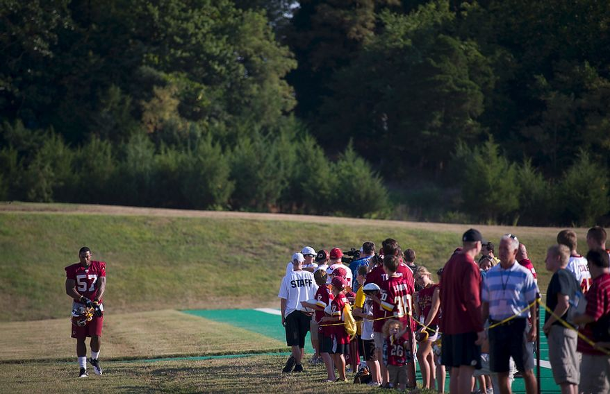 Washington Redskins linebacker Markus White (57) passes a crowd of fans as he arrives on the field for another day of training camp at Redskins Park in Ashburn, Va., Monday, August 1, 2011. (Rod Lamkey Jr./The Washington Times)