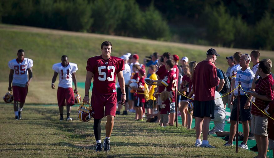 Washington Redskins linebacker Ryan Kerrigan (53) arrives on the field for another day of training camp at Redskins Park in Ashburn, Va., on August 1, 2011. (Rod Lamkey Jr./The Washington Times)