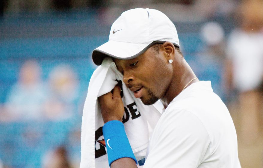 Donald Young of the U.S. wipes sweat from his face in the first set of the match against Artem Sitak of New Zealand during the first full night of Main Draw play in the 8-day long Legg Mason Tennis Classic at William H.G. FitzGerald Tennis Center in Rock Creek Park in Northwest Washington, D.C. on Monday, August 1, 2011. (Pratik Shah/The Washington Times)
