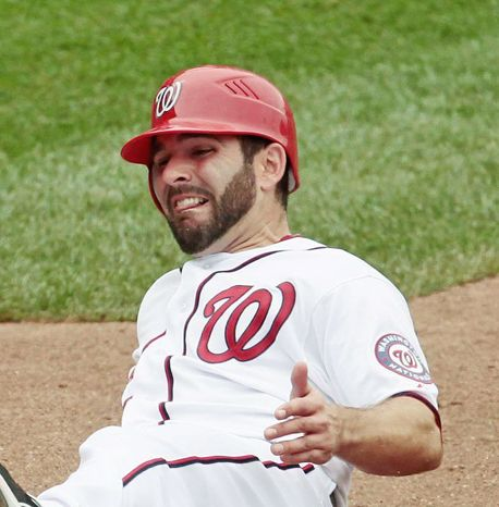 Nationals second baseman Danny Espinosa seems to have dodged a major shoulder injury after an MRI revealed a bone bruise and inflammation. (Associated Press)