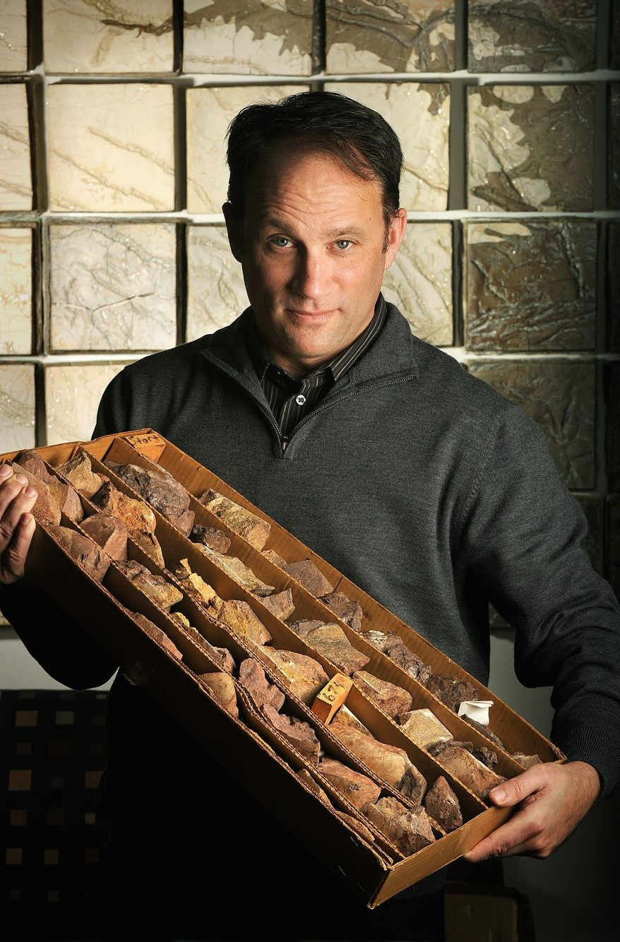 Geologist Matt Joeckel displays a core sample of carbonatite rock containing niobium and rare-earth elements, which was taken from a deposit near Elk Creek, Neb., in early February. (Associated Press)