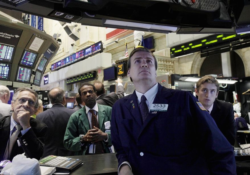 Specialist Patrick King, second from right, and others watch President Barack Obama's remarks on a television monitor the floor of the New York Stock Exchange Tuesday, Aug. 2, 2011. The stock market stumbled again Tuesday and is on pace for its longest losing streak in two years.(AP Photo/Richard Drew)