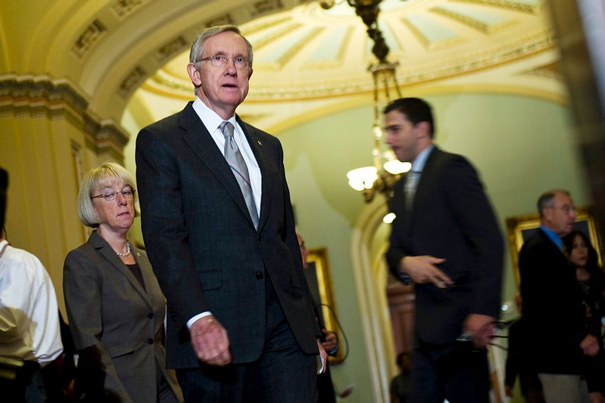 Senate Majority Leader Harry Reid, D-Nev., leaves the Senate floor after they passed the debt ceiling plan, on Capitol Hill, in Washington, D.C., Tuesday, Aug. 2, 2011. (Drew Angerer/The Washington Times)