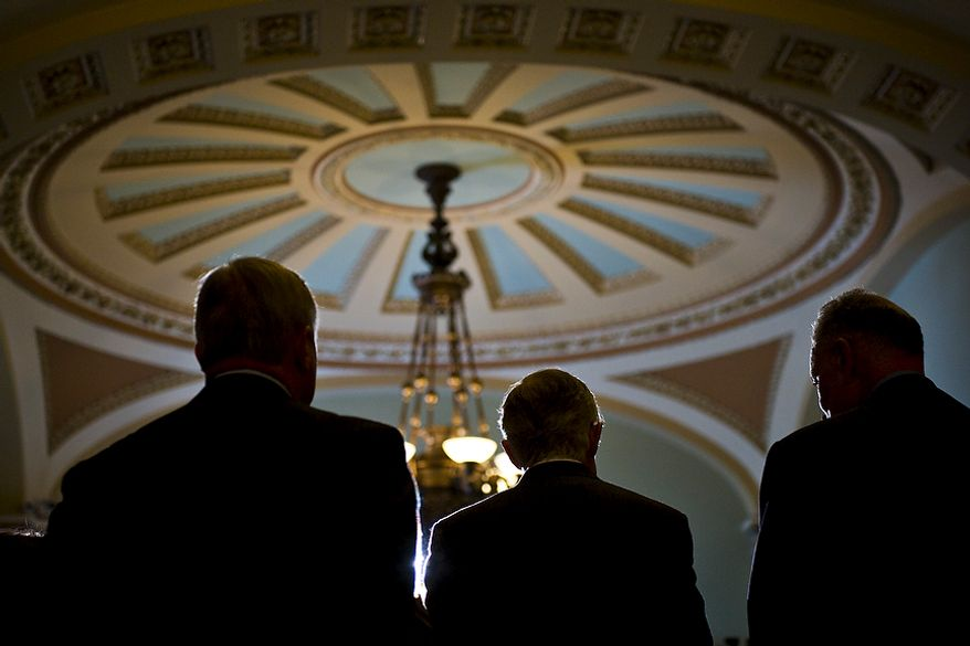 From left, Sen. Dick Durbin, D-Ill., Senate Majority Leader Harry Reid, D-Nev., and Sen. Chuck Schumer, D-N.Y., speak to the media after the Senate passed the debt ceiling plan, on Capitol Hill, in Washington, D.C., Tuesday, Aug. 2, 2011. (Drew Angerer/The Washington Times)