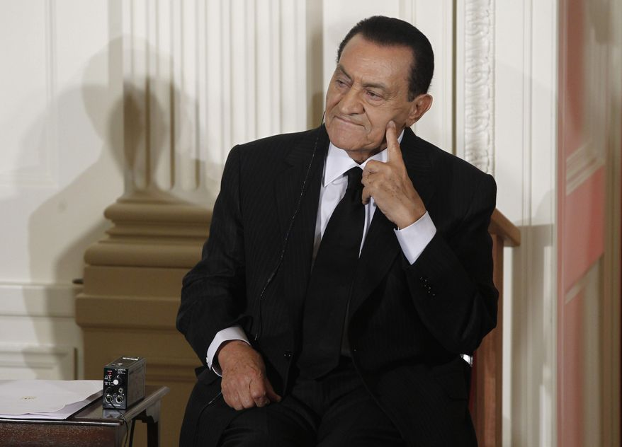 ** FILE ** Ousted Egyptian President Hosni Mubarak, 83 years old and ailing, goes on trial Wednesday, Aug. 3, 2011 on charges of corruption and ordering the killing of protesters during the 18-day uprising that toppled him. Many Egyptians are celebrating the chance at retribution against a longtime authoritarian ruler. (AP Photo/Charles Dharapak, File)