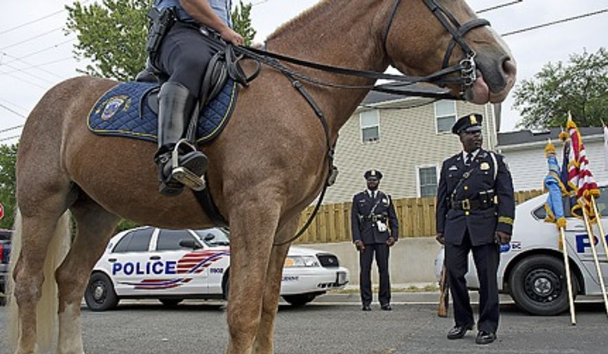 Police have made efforts to increase their presence in the Deanwood neighborhood in Northeast D.C., but some residents say it's not enough. (The Washington Times/File)