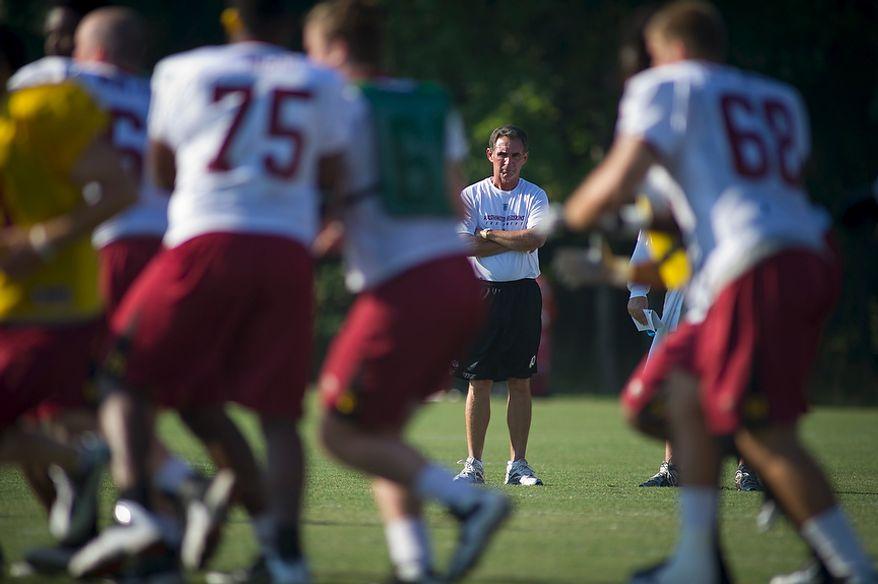 Washington Redskins Head Coach Mike Shanahan keeps an eye on the moves during training camp at Redskins Park in Ashburn, Va., Tuesday, August 2, 2011. (Rod Lamkey Jr./The Washington Times)
