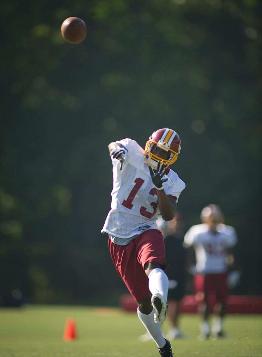 Washington Redskins wide receiver Anthony Armstrong (13) makes a throw during drills at training camp at Redskins Park in Ashburn, Va., Tuesday, August 2, 2011. (Rod Lamkey Jr./The Washington Times)
