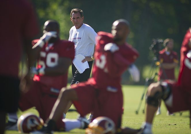 Washington Redskins Head Coach Mike Shanahan keeps an eye on the moves during training camp at Redskins Park in Ashburn, Va., Tuesday, August 2, 2011. (Rod Lamkey Jr./The Washington Times)