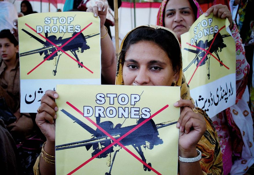 **FILE** Pakistan women participate in a rally against the U.S. drone strikes in tribal areas in Peshawar, Pakistan, on April 23, 2011. (Associated Press)