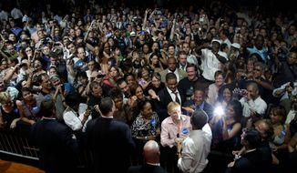 President Obama greets attendees after speaking at the Aragon Ballroom in Chicago on Wednesday at a fundraiser on the eve of his 50th birthday. (Associated Press)