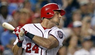 Washington Nationals center fielder Rick Ankiel follows through on his grand slam during the fourth inning against the Atlanta Braves on Tuesday. The Nationals won 9-3. (AP Photo/Manuel Balce Ceneta)