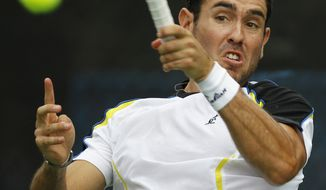 Wayne Odesnik follows through on a return to Radek Stepanek during a match at the Legg Mason Tennis Classic on Wednesday. (AP Photo/Luis M. Alvarez)