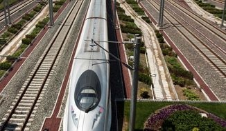 Associated Press photographs China has hailed its bullet train as part of its plans for far-reaching technology, but critics say the nation's poor majority need cheaper transportation tickets - not record-setting speeds of 190 mph or more.