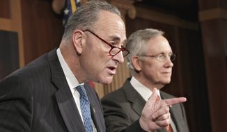 Sen. Charles Schumer (left), New York Democrat, accompanied by Senate Majority Leader Harry Reid, Nevada Democrat, gestures during a news conference on Capitol Hill on Aug. 3, 2011, to discuss the partial shutdown of the Federal Aviation Administration. (Associated Press)