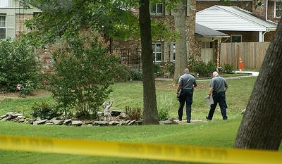 Prince George's County crime scene investigators head back into the Fort Washington, Md. home where Patricia Harris and her son, Frank Harris, Jr., were found shot to death Thursday morning August 4, 2010.(Andrea Noble/The Washington Times)