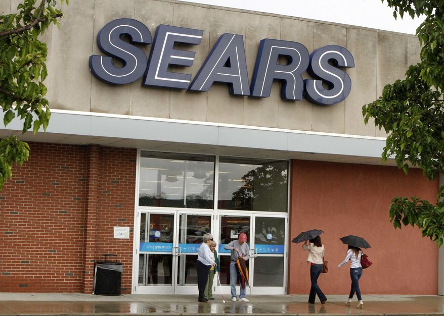In this May 18, 2011, photo, customers enter and exit a Sears store in Bethel Park, Pa. Retailers are reporting solid sales gains for July, Thursday, Aug. 4, 2011, as deep discounts and sweltering heat drove shoppers to air conditioned malls. (AP Photo/Gene J. Puskar)