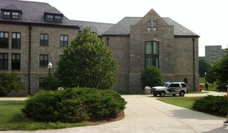 """** FILE ** Peddrew-Yates Residence Hall, near Dietrick Dining Center, is locked down on Thursday, Aug. 4, 2011, on the Virginia Tech Campus in Blacksburg, Va., after three youths attending a summer camp on Virginia Tech's campus said they saw a man outside New Residence Hall East """"holding what may have been a handgun,"""" the university said. (AP Photo/The Roanoke Times, Rebecca Barnett)"""