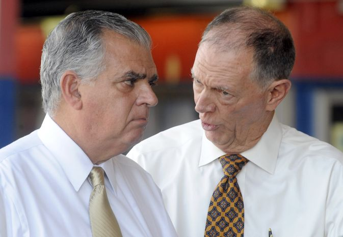 ** FILE ** U.S. Transportation Secretary Ray LaHood, left, talks to FAA Administrator Randy Babbitt during a news conference to discuss the interruption of federal funding for airport construction projects and contractors at LaGuardia Airport in New York, Monday, Aug. 1, 2011. (AP Photo/Henny Ray Abrams)