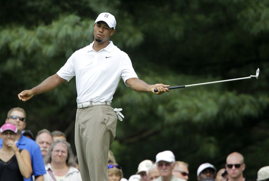Tiger Woods reacts after missing a birdie putt on the 8th hole during the second round of the Bridgestone Invitational golf tournament at Firestone Country Club in Akron, Ohio Friday, Aug. 5, 2011. (AP Photo/Mark Duncan)