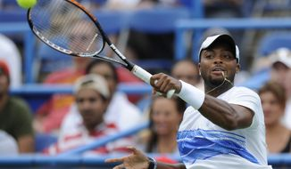 Donald Young returns the ball to Marcos Baghdatis during a match at the Legg Mason Tennis Classic on Friday. (AP Photo/Nick Wass)
