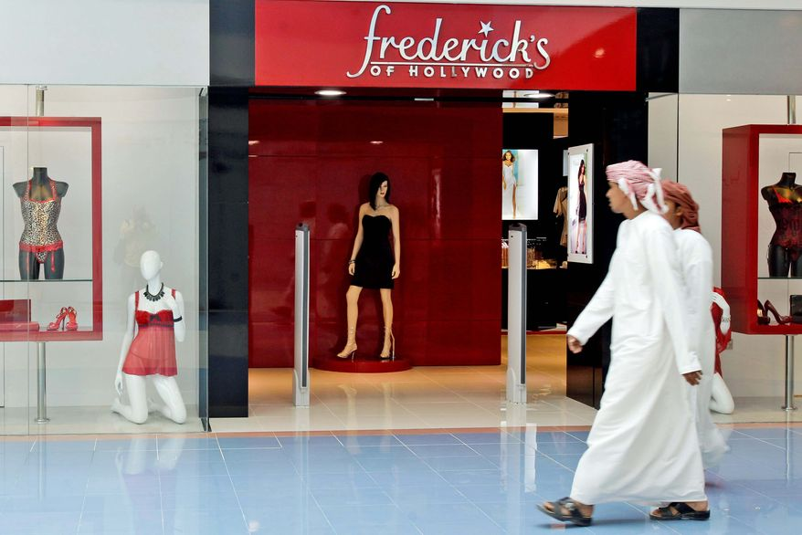 ASSOCIATED PRESS An Emirati man looks at a lingerie display as he passes in front of Frederick's of Hollywood at a shopping mall in Abu Dhabi, United Arab Emirates. The lingerie retailer chose the Emirates for the launch of its first international store. In only a few short years, this desert country has emerged as an unlikely first port of call for retailers looking to test their brands overseas.
