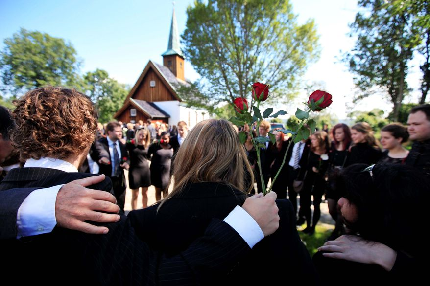 ASSOCIATED PRESS PHOTOGRAPHS Mourners attend the funeral of massacre victim Bano Abobakar Rashid in Nesodden, Norway. The 18-year-old, whose family fled to Norway from Iran in 1996, was one of the victims of the July 22 massacre. Last Monday, people gather outside the Oslo Cathedral amid thousands of flowers and tributes (below) to remember the 77 victims of the July 22 bomb blast in Oslo and the shooting rampage on nearby Utoya Island hours later. Anders Behring Breivik (top) has confessed to the killings.