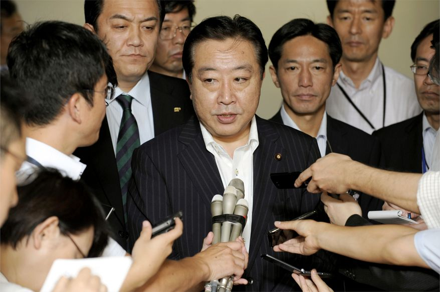 Japanese Finance Minister Yoshihiko Noda speaks to reporters at the ministry in Tokyo Monday morning, Aug. 8, 2011 before the beginning of the day's stock trading in Japan. Financial ministers from the Group of Seven economies, including Noda, held talks on world market stability as Middle Eastern markets tumbled Sunday in the first sign of investor fallout from a historic U.S. credit downgrade. (AP Photo/Kyodo News)