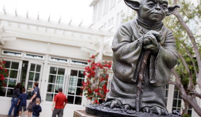 "ASSOCIATED PRESS A statue of the Jedi master Yoda at Lucasfilm Ltd.'s headquarters in San Francisco is one of many special sites visited by ""Star Wars"" fans from around the globe. Other locations include a desert in Tunisia and a Tuscan lakefront villa."