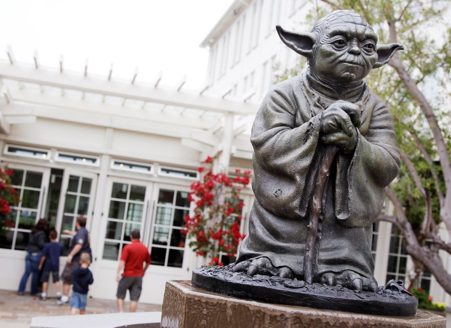 """ASSOCIATED PRESS A statue of the Jedi master Yoda at Lucasfilm Ltd.'s headquarters in San Francisco is one of many special sites visited by """"Star Wars"""" fans from around the globe. Other locations include a desert in Tunisia and a Tuscan lakefront villa."""