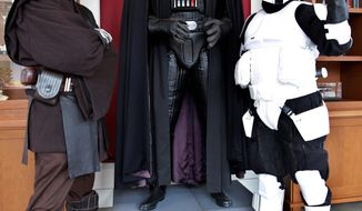 "** FILE ** ""Star Wars"" fans Matt Tolosa (left), dressed as Anakin Skywalker, and his brother Dale, dressed as a Stormtrooper, pose with a Darth Vader mannequin at the Lucasfilm Ltd. headquarters in San Francisco.(Associated Press)"