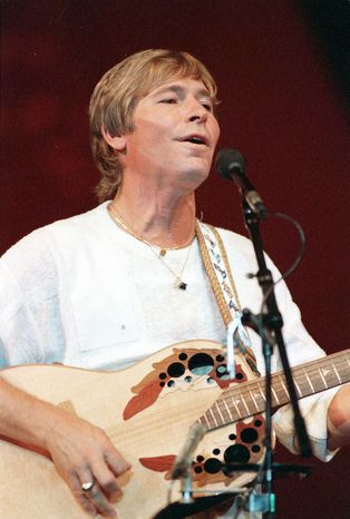 "ASSOCIATED PRESS John Denver's ""Rocky Mountain High"" is one of Colorado's two state songs, but an effort to name a Rockies peak for him has hit a snag. He's seen here in 1985."