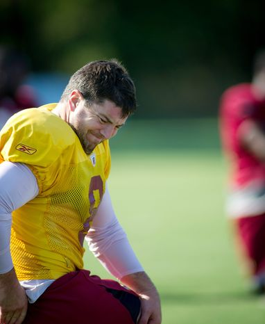 ROD LAMKEY JR./THE WASHINGTON TIMES Redskins quarterback Rex Grossman, doing stretching exercises Monday, is locked in a battle with John Beck to be the starter.